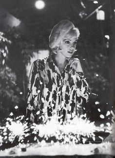 """Monroe. (Marilyn receiving her birthday cake on the set of """"Something's Got to Give,"""" June 1, 1962. Sadly, Marilyn died just a little over two months later, making this her last birthday cake.)"""