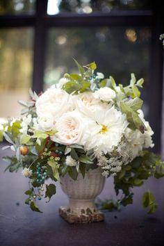 urn center piece - here with white garden roses, ranunculus, dahlias.