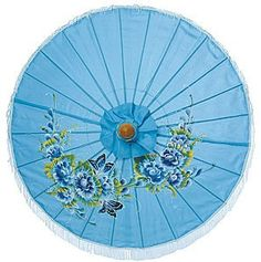 An especially festive parasol! This fabric parasol carries a beautiful Asian style floral painting. It is 28 inches in diameter and has a 25 inch bamboo stem with a carved wooden handle. It is made with fringed nylon fabric and the top is decorated with a carved wooden finial. Both the handle and finial are made with sustainably grown wood.