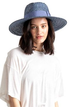 This woven straw hat features a wide brim that provides ample shade and Western attitude as you stroll the boardwalk or through the market.