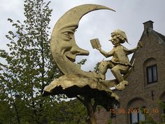Man and Moon - with a bedtime story, of course.  Spotted in main square in Diksmuide, West Flanders, Belgium;  photo by davidezartz