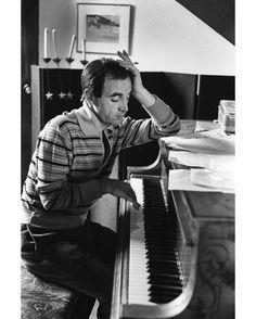 """#1960. Dans son appartement parisien Charles #Aznavour au piano en pleine composition. Iil a 36 ans et vient de chanter à l'Alhambra. Après avoir interpreté sept chansons devant un public froid l'artiste sors son ultime atout """" Je me voyais déjà"""" Il voit alors la salle crouler alors sous un tonnerre d'applaudissements et c'est un triomphe . Photo : Gerard Gery/ #ParisMatch. by parismatch_vintage"""
