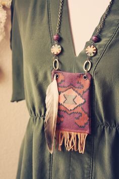 ikat fringe and feather necklace- ooh I bet I could make something like this...