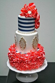 Blue, white and coral cake with stripes and gold