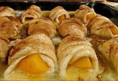 Peaches and Crescent Rolls INGREDIENTS: 2 Whole large peaches 2 8 oz. cans crescent rolls 2 sticks butter 1 and ½ cup sugar 1 tsp. vanilla Cinnamon, to taste 1 12 oz. can Mountain Dew Peel and pit … Mountain Dew, Dessert Simple, Peach Dumplings, Crescent Roll Recipes, Peach Cobbler Crescent Rolls Recipe, Dessert With Crescent Rolls, Peach Crescent Rolls, Dumpling Recipe, Homemade Dumplings