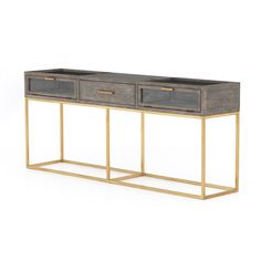 A clean-lined console of ash grey oak features a polished brass base and three drawers with linear pulls, bringing a modern look to rustic materials. Brass Console Table, Modern Console Tables, Grey Oak, Ash Grey, Neutral Carpet, Grey Carpet, Wood Shadow Box, Cheap Carpet Runners, Gold Table