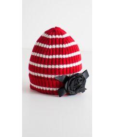 Cappello a cuffia con fiore disponibile anche in nero.