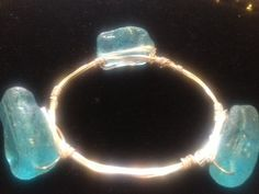 Handmade Wire Wrapped Bracelet, aqua sea glass stones on artistic wire, silver non-tarnishable wire on Etsy, $22.00