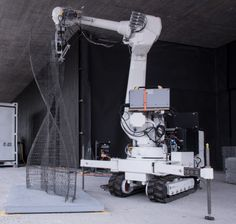 A construction robot has to be powerful enough to handle heavy material, small enough to enter standard buildings, and flexible enough to navigate the terrain.