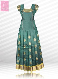 Look pretty and elegant in this beautiful kanchipuram silk pattu pavadai highlighted with gold motifs all over.