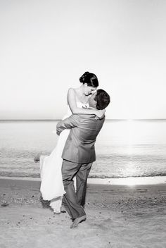 Black and white beach wedding picture by Emma Burdis.