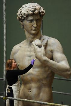 Sculpture conservator Johanna Puisto unveils a cast of Michaelangelo's David at Victoria & Albert Museum in London