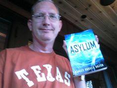My husband holding my book!