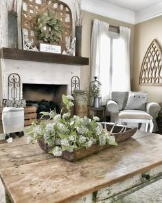 You have to see this #farmhouse living room decor idea with a rustic table and farmhouse signs. Love it! #RusticDecor #HomeDecorIdeas