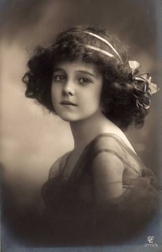 Pretty young girl with ribbons in her hair postcard