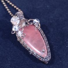 Handmade pendant with red cherry quartz in oxidized antiqued copper wire. Unique wire wrapped vintage jewelry with botanical accents. Victorian inspired. 2 X 7/8 inch ( 5 X 2.3 cm ) with a chain ( 18 Inch )  Matching earrings: https://www.etsy.com/listing/491744584/handmade-earrings-with-red-cherry-quartz
