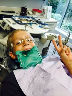 Happy young patient with dental rubber dam. Tooth isolation, a must for white fillings and safety.