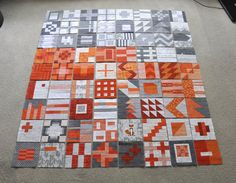 More Tula Pink City Sampler quilt blocks done. All oranges and greys.