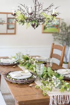 Natural Spring Tablescape | Recreate this natural spring tablescape and dining room vignette for Easter using ferns, moss, eggs, flowers, and flowering branches! #farmhouse #spring #tablescape #easter #flowers #natural #homedecor