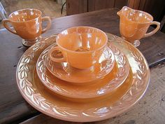 Set in Peach Lustre Laurel pattern from Fire King. 1 Dinner, 1 Salad, 1 Cup & Saucer, 1 Creamer & Sugar. $22.00/6-pcs at EspritBrocante on etsy, 10/3/15