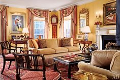 A gloomy living room in Boston brightens up in the hands of architect Ray Pohl and interior designer Elissa Cullman. In addition to painting the walls a warm yellow, the pair installed bolder crown molding as well as a formal marble mantel with complementary golden accents (2006).
