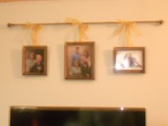 Curtain Rod with photos hanging from it!  If you don't know what to do with a wall this can save the day, above our TV was a bare wall, and this decorating tip really completed the space.  -Mom and Me over Christmas Break  @Martha DePinho