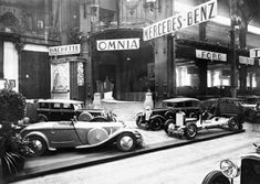 The Mercedes Benz booth in the Paris motor show, 1928.  They always had a way of making really beautiful and expensive cars look even more beautiful and expensive.