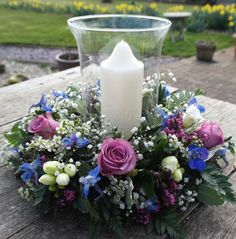 Great alternative to high table centrepiece but still beautiful & has an impact