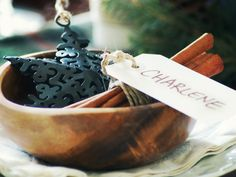 A soup bowl doubles as a place card holder and carries an ornament for each guest to take home as a gift.