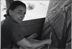 """""""Georgia O'Keefe painting in her car, Ghost Ranch, 1937"""" by Ansel Adams"""