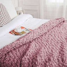 Paignton Dusky Pink Throw | Dunelm |  Finished in a beautiful dusky pink shade, this chunky Paignton throw features a densely woven knitted texture for maximum comfort.