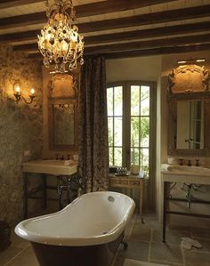 With its exposed stone walls, flagstone floors and rich upholstery, the Basilico Garden Suite is the perfect accomodation for a luxury vacation in Tuscany. Bad Inspiration, Bathroom Inspiration, Bathroom Ideas, Romantic Bath, Hanging Chandelier, Chandeliers, Dream Bath, Tuscan House, Classic Interior