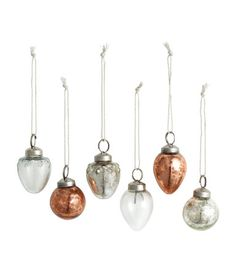 Silver-colored/copper-colored. Glass Christmas ornaments in various colors and shapes. Metal hanger at top with fabric hanger loop. Length approx. 1 in.