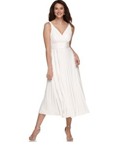 Really like this white flowy sleeveless dress for a casual yet elegantly informal destination beach wedding