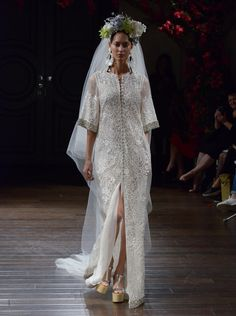 Naeem Khan Fall 2016 embroidered caftan wedding dress with jeweled cuff and hem | https://www.theknot.com/content/naeem-khan-wedding-dresses-bridal-fashion-week-fall-2016