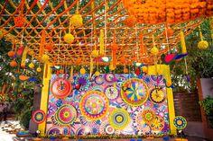 Vibrant colors backdrop / entry/ photobooth at the Mehndi function. Marigol fresh flower decoration. Mela themed Mehndi