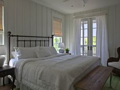 SallyL: Geoff Chick - Batten and board wall treatment with hardwood floors. French doors with ...