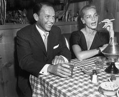 Frank Sinatra and Lauren Bacall, at a Hollywood restaurant in October, 1957.