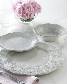 """""""Merletto"""" Dinnerware by Arte Italica - An intricate, lace-inspired embossed pattern lends formality to this dinnerware while assorted shapes add further interest, making it easy to create a monochromatic statement that plays to form and texture. But we also like the way it mixes with other patterns—the oversized plates encourage layering."""