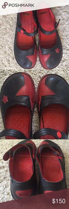 Camper Twins Circus Mary Janes Soft black leather with red stars make this a one of a kind shoe, literally. Each one together makes a pair but unique in and of itself. Camper is more than a shoe company. It's the result of a dream of a family from Mallorca, Spain who have been making shoes since 1877. A Mediterranean dream that is all about being, living and dreaming. Like new. No box. Camper Shoes Flats & Loafers
