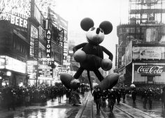"""Mickey Mouse made his debut appearance in the """"Macy's Santa Claus Parade"""" (now Macy's Thanksgiving Day Parade) in 1934. Measuring 40-feet-tall, the balloon was hand painted and guided by men and women dressed in Mickey/Minnie Mouse costumes."""