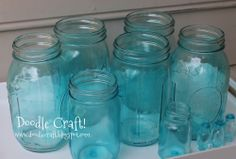 Glass jars + Elmers glue + food coloring (mix, drain upside down, & Bake for 30 mins (400* F)) = Tinted Mason Jars