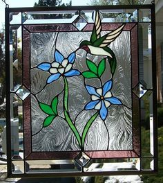 stained glass hummingbird and flowers