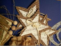 10 Beautiful Sheet Music Christmas Ornaments You Can Make Yourself five pointed star sheet music craft Music Christmas Ornaments, Christmas Sheet Music, Paper Ornaments, Christmas Art, Christmas Projects, Handmade Christmas, Holiday Crafts, Vintage Christmas, Christmas Decorations
