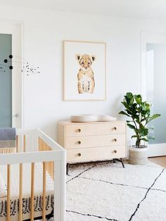 Adorable minimalist nursery ideas with a modern boho vibe. I am loving the vibe of this gender neutral nursery! Adorable Animal themed nursery with oversized area rug on light hardwood floors. Every nursery needs a fiddle fig tree in a basket, am I right? Nursery Themes, Nursery Room, Kids Bedroom, Nursery Ideas, Nursery Decor, Bedroom Decor, Lion Nursery, Animal Theme Nursery, Nursery Inspiration