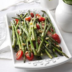 Tuscan-Style Roasted Asparagus Recipe -This is especially wonderful when locally grown asparagus is in season and so easy for celebrations because you can serve it hot or cold. —Jannine Fisk, Malden, Massachusetts