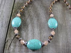 "Turquoise Silver and Peach Bead Set Charm Pendant Beaded Necklace with Gold Smoky Topaz and Peach Seed Bead Glass Bead Accents. Necklace length is approximately 22"" in length from clasp to clasp. Toggle Closure. https://www.etsy.com/listing/200286185/turquoise-silver-and-peach-bead-set"