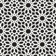Agar Screen | 5006642 in Ebony | Schumacher Wallpaper by Martyn Lawrence Bullard |  Agadir Screen's geometric floral pattern has a dazzling kaleidoscopic effect. Also available as a printed mylar, it is reminiscent of a stained glass window or an exotic screen.