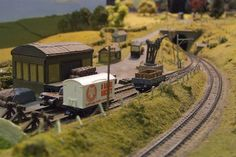 """""""On the late lamented Somerset and Dorset railway. An extremely impressive layout at the Brighton Modelworld. Midford station itself is the far side of the tunnel visable in the distance. This is Midfords goods station."""" 