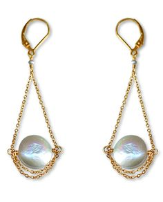 Glamorous! These earrings are delicate and beautiful and look equally good with a bridal gown or when worn with a pair of jeans, snazzy heels and your favorite dressy top. Item Number: E1116 Specifica